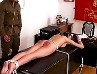 Pretty young girl is strictly bound to a table for a brutal spanking
