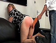 Luscious assed blonde with her knickers dangling gets spanked on the sofa - bouncing red buttocks