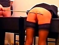 Three school girls bend over the desk for a harsh bare bottom caning - real tears