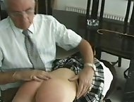 Two naughty bitches get their round asses caned and are throbbing red
