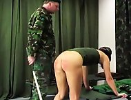 Valerie has not made her bed according to army regulations and receives a good caning from her taskmaster.  He orders her to remove her pants and unde