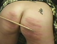 Redheaded Tart gets caned for bad behavior